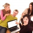 Group of students with laptop on white — Stockfoto