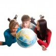 Young looking at globe — Stock Photo