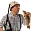 Fisherman with fishing rod and his catch — Stock Photo #1670882