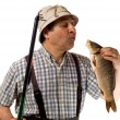 Fisherman with fishing rod and his catch - Stock Photo