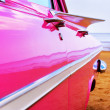 Classic pink Cadillac at beach — Stock Photo
