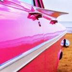 Classic pink Cadillac at beach — Stock Photo