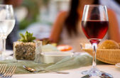 Served table with red wine at restaurant — Stock Photo