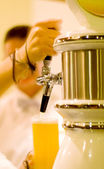 Bartender pouring beer (shallow dof) — Stock Photo