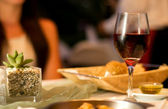 Served table with red wine at restaurant — Photo