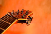 Close-up of the top of a black electric guitar — Stock Photo