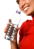 Young smiling girl with mineral water — Stock Photo