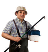 Fisherman with fishing rod and gear — Stock Photo