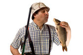 Fisherman with fishing rod and his catch — Stock Photo