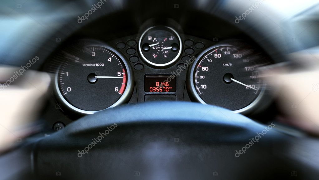 Car panel instrument speedometer and tachometer (shallow dof) — Stock Photo #1670979