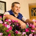 Man florist working in the garden — Stock Photo