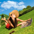Stock Photo: Woman reading magazine