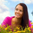 Stock Photo: Young beautiful woman resting on the meadow