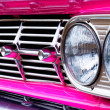 Close-up of car grill (pink Caddie) — Stock Photo #1694144