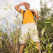 Young man hiker on the hill - Stock Photo