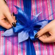 Beautiful hands wrapping giftbox - Stock Photo