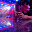 Young beautiful woman in the nightclub — Stock Photo