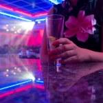 Young beautiful woman in the nightclub — Stock Photo