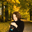 Young woman in the park - Stok fotoğraf