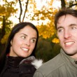 Stock Photo: Happy couple in the evening park (girl in focus)