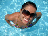 Funny looking young woman in the pool — Stock Photo