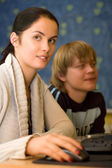 Two students are doing homework (shallow dof) — Foto Stock