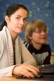 Two students are doing homework (shallow dof) — Zdjęcie stockowe