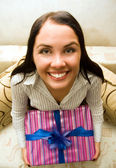 Funny girl holding a gift box — Stock Photo