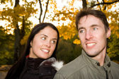 Happy couple in the evening park (girl in focus) — Photo