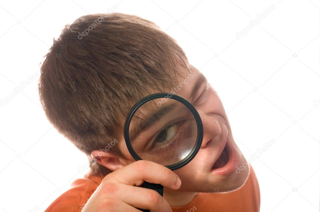 Nerd guy with magnifying glass (shallow dof) — Stock Photo #1694451