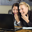 Two girls with laptop in the office — Stock Photo #1707096