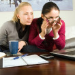 Two girls with laptop in the office — Stock Photo