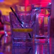 Stock Photo: Glass of alcohol drink in the night club