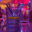 Glass of alcohol drink in the night club - Stock Photo
