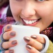 Woman holding a cup of coffee — ストック写真