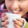 Stock Photo: Woman holding a cup of coffee