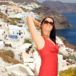 Greek woman on the streets of Oia - Stock Photo