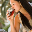Woman tasting red wine — Stock Photo #1711728