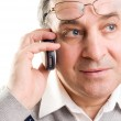 Senior man talking on mobile phone — Stock Photo #1711881
