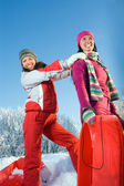 Beautiful girls with sledges — Stock Photo