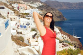 Greek woman on the streets of Oia — Stock Photo
