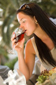 Woman tasting red wine — Stock Photo