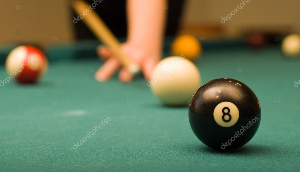 Billiard game (black ball in focus) — Stock Photo #1710740