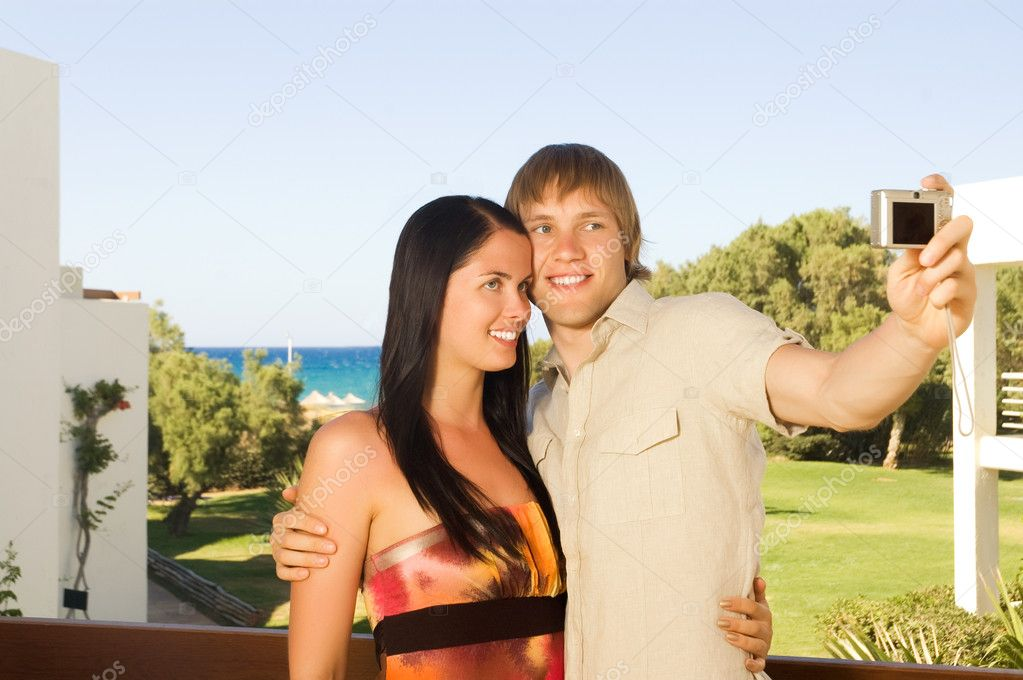 Young couple taking a photo of themselves — Stock Photo #1711525