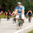 The motion blurred cyclists at cycle event - Stock Photo