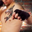 Street fighter (focus on fist) - Stock Photo