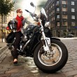 Stock Photo: Beautiful womon motorcycle