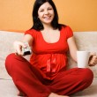 Pregnant woman sitting on the couch — Stock Photo #1727628