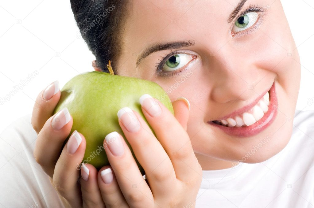 Beautiful young woman holding an apple — Stock Photo #1725277