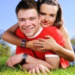 A happy couple on a green meadow — Stock Photo #1953195